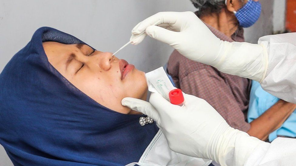 Covid: Reused nose swab scam busted in Indonesia airport